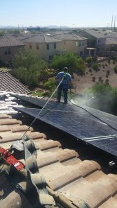 Pressure washing under solar panels and on top of solar panels to clean pigeon poop